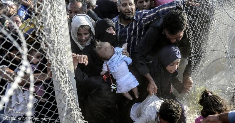 Personas refugiadas sirias huyendo del horror de la guerra ©BULENT KILIC/AFP/Getty Images