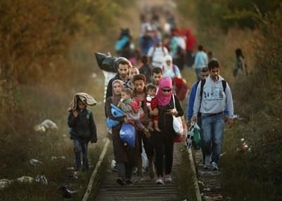 Personas refugiadas cruzando Europa, septiembre de 2015. © Christopher Furlong/Getty Images